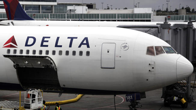 1 Plane Clips Another at Gate at Boston's Logan Airport