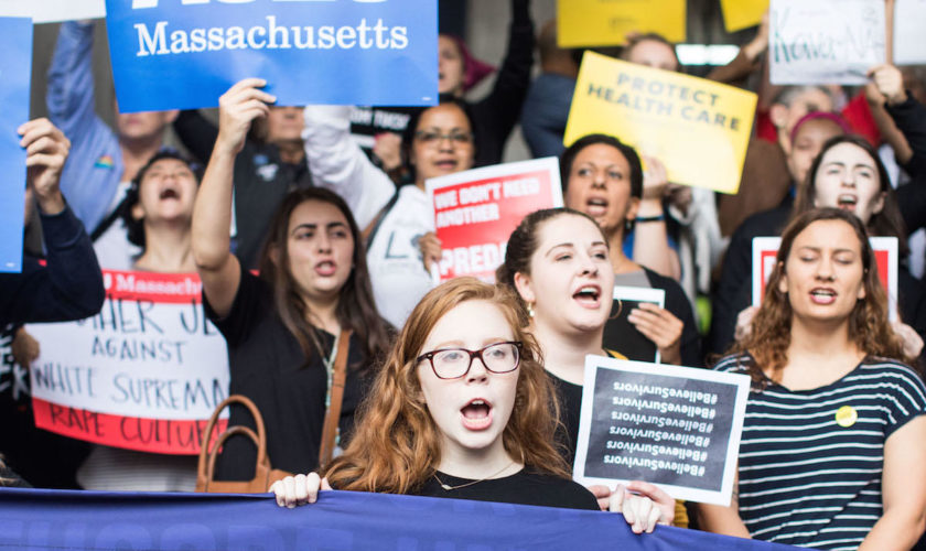 PHOTOS: Anti-Kavanaugh Protestors Greet Sen. Flake in Boston
