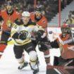 Bruins, Krug 'wake up' and win in OT