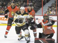 Bruins, Krug 'wake up' and win in OT