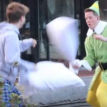 "Boston firefighter dressed as ""Buddy the Elf"" challenges strangers to pillow fights"