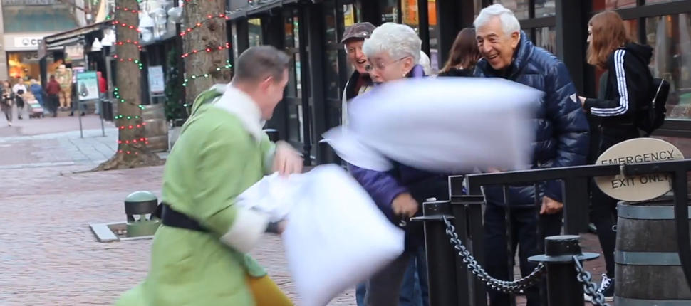 "Boston firefighter spreads holiday cheer with pillow fights as ""Buddy the Elf"""